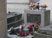 The grave of the leader of the rock group The Doors Jim Morrison pictured on April 19 2014 at the Pere Lachaise cemetery in Paris The Doors created...