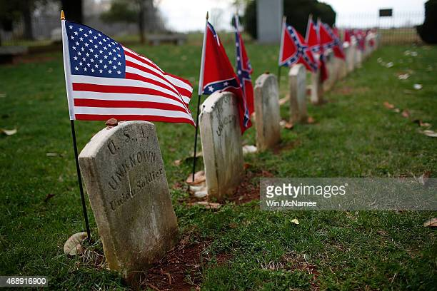 The graves of a Union soldier with Confederate soldiers are shown at sunset at the Appomattox Court House National Historical Park April 7 2015 in...