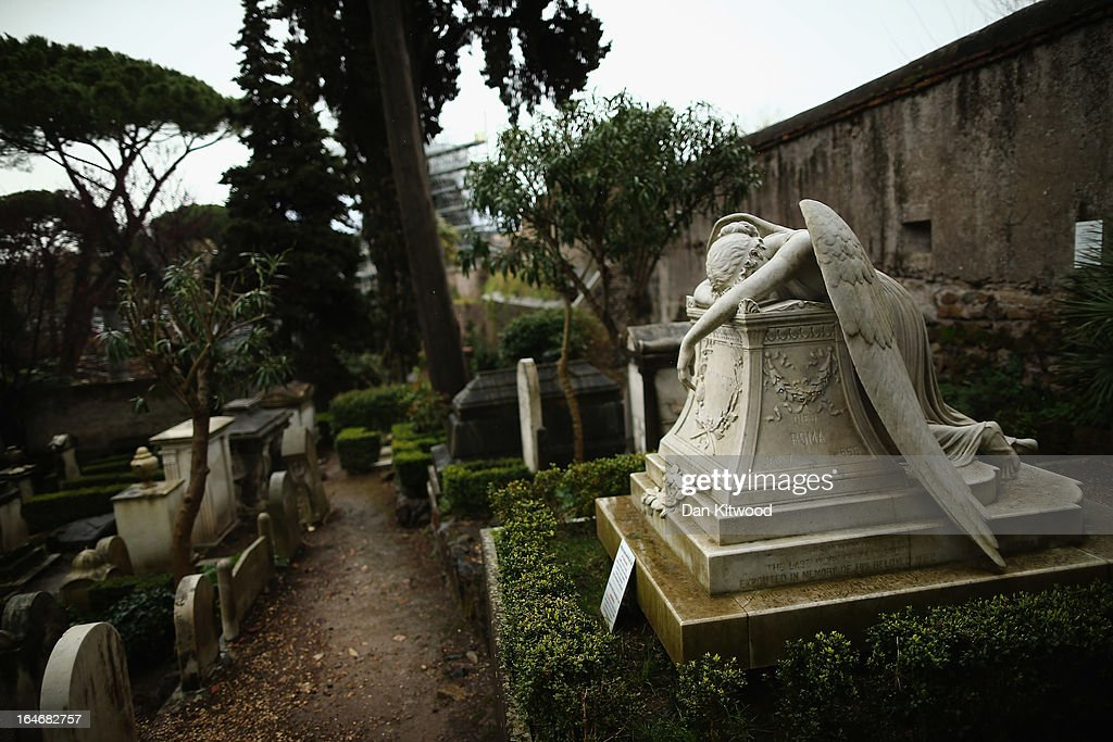 The gravestone of prominent American sculptor William Wetmore Story's wife Emelyn, (R) stands in Rome's 'Non Catholic Cemetery' on March 26, 2013 in Rome, Italy. After working as a sculptor for 40 years Wetmore died in 1895, and was buried in the same tomb. Rome's Non-Catholic Cemetery contains one of the highest densities of famous and important graves anywhere in the world including John Keats, one of England's most famous poets, who died early in 1820 of tuberculosis aged 25, after travelling to Italy in search of a better climate to help cure him of the disease. As well as being the final resting-place of the poets Percy Shelley and John Keats, it is also home to graves of many other painters, sculptors and authors who died in Rome. The cemetery which began it's use in 1730 continues today, containing graves of Orthodox Christians, Jews, Muslims and other non-Christians, and is one of the oldest burial grounds in Europe.