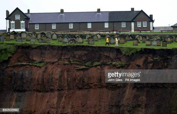 The Graveyard of St Marys Church Whitby Yorkshire made famous in the Dracula story stands close to the edge of the cliff which was formed by...