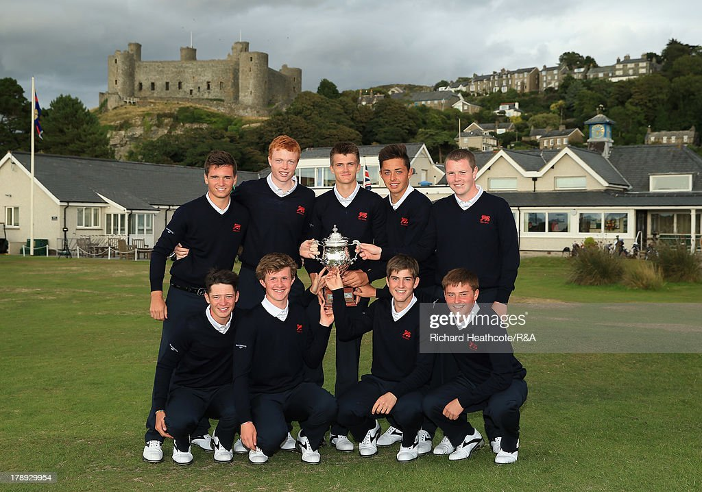 The Great Britain and Ireland team pose with the trophy after securing victory during the second day of the Jacques Leglise Trophy at Royal St David's Golf Club on August 31, 2013 in Harlech, Wales.