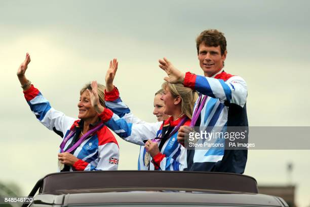 The Great Britain Silver Medal Eventing team Mary King Zara Phillips Nicola Wilson and William FoxPitt go on a parade on the show jumping day during...