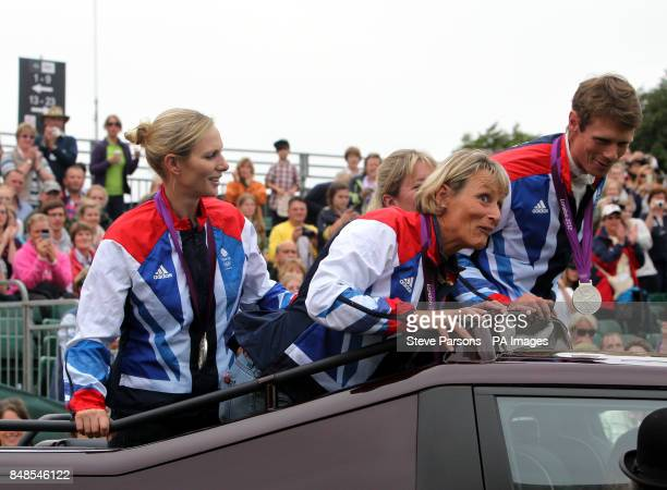 The Great Britain Silver Medal Eventing team Zara Phillips Mary King Nicola Wilson and William FoxPitt go on a parade on the show jumping day during...