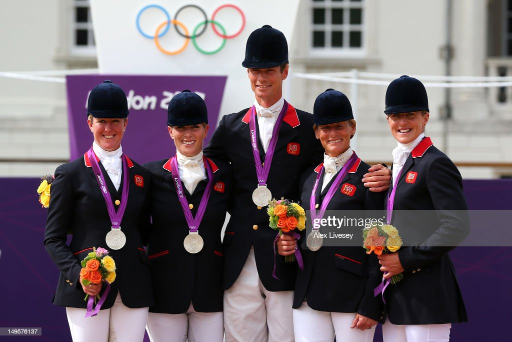 The Great Britain team celebrate on the podium after being presented with the Silver medal in the Eventing Team Jumping Final Equestrian event on Day 4 of the London 2012 Olympic Games at Greenwich Park on July 31, 2012 in London, England.