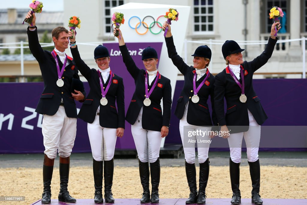 The Great Britain team celebrate on the podium after winning the Silver medal in the Eventing Team Jumping Final Equestrian event on Day 4 of the London 2012 Olympic Games at Greenwich Park on July 31, 2012 in London, England.