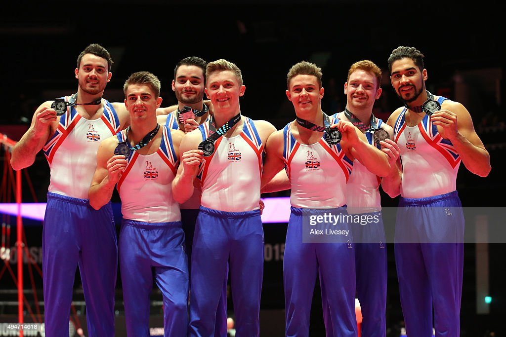 The Great Britain team celebrate winning Silver after day six of the 2015 World Artistic Gymnastics Championships at The SSE Hydro on October 28, 2015 in Glasgow, Scotland.