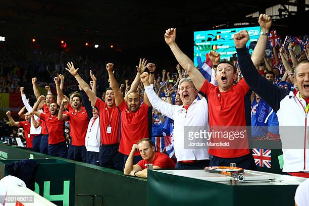 The Great Britain team coaching staff cheer as Andy Murray win's his singles match against David Goffin of Belgium their victory during day three of...