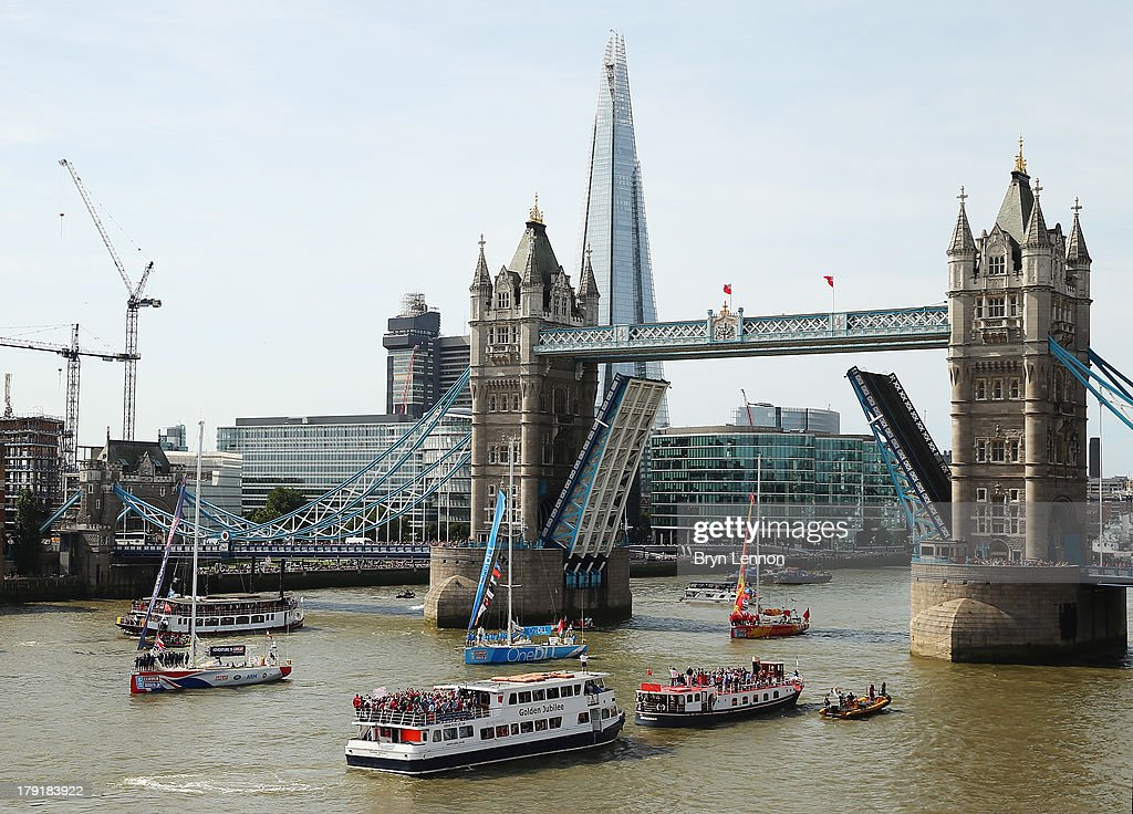 The Great Britain team lead the boats under Tower Bridge at the start of the Clipper Round The World Yacht Race at Tower Bridge on September 1, 2013 in London, England.