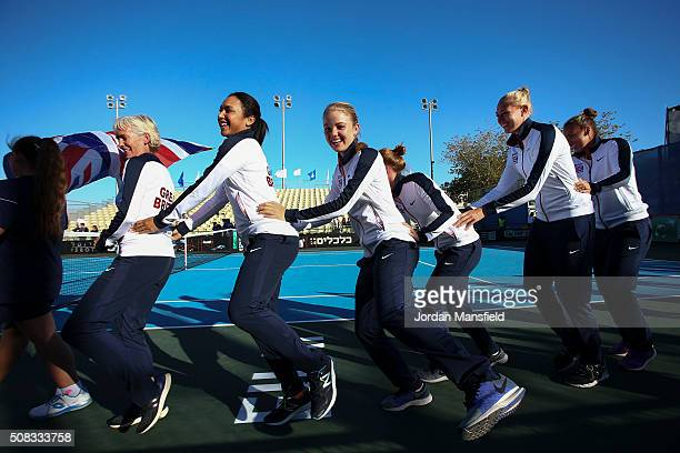 The Great Britain team of Captain Judy Murray Heather Watson Katie Swan Anna Smith Jocelyn Rae and Freya Christie dance out of the opening ceremony...