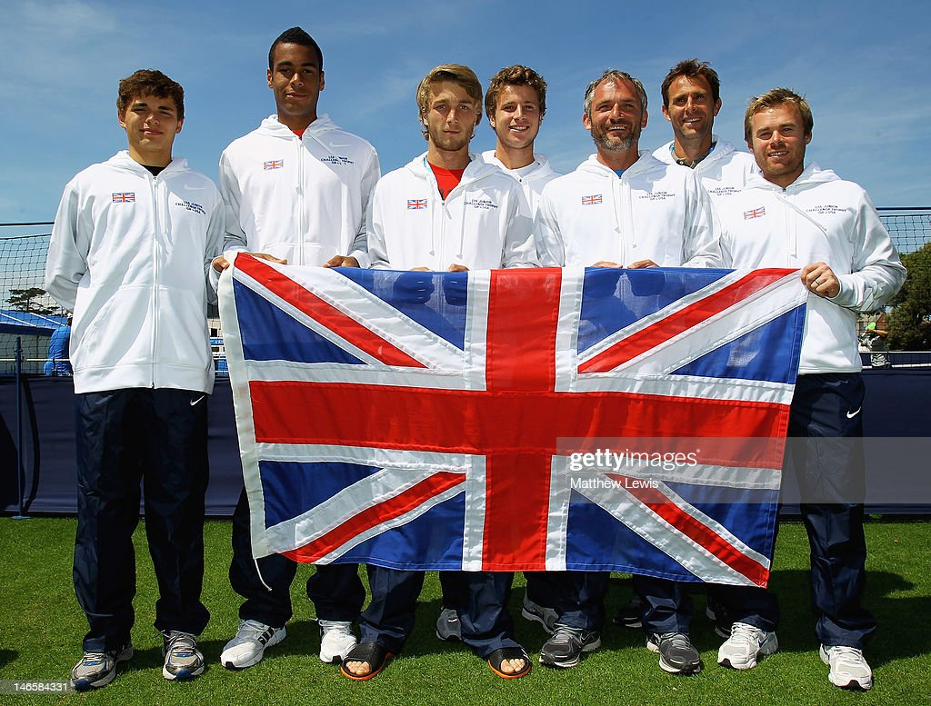 The Great Britain team of Joshua Ward-Hibbert, Liam Broady, Luke Bambridge, Peter Ashley, Coach Martin Weston and Mark Hilton ahead of the LTA Junior Challenge trophy during day five of the AEGON International on June 20, 2012 in Eastbourne, England.