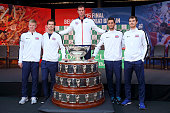 The Great Britain team of Kyle Edmund Andy Murray Captain Leon Smith James Ward and Jamie Murray pose for photo with the Davis Cup during the draw...