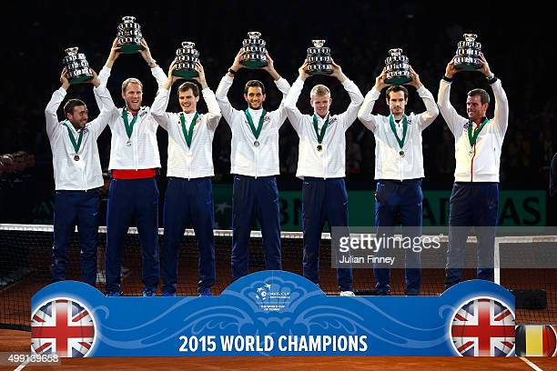 The Great Britain team pose with their trophies following victory on day three of the Davis Cup Final 2015 at Flanders Expo on November 29 2015 in...