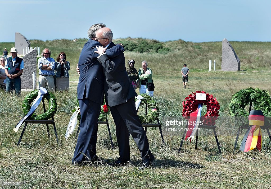 The great grandson after the German admiral Reinhardt ScheerHenning and the grandson Nick Jellicoe after British Admiral John Jellicoe embrace as a...