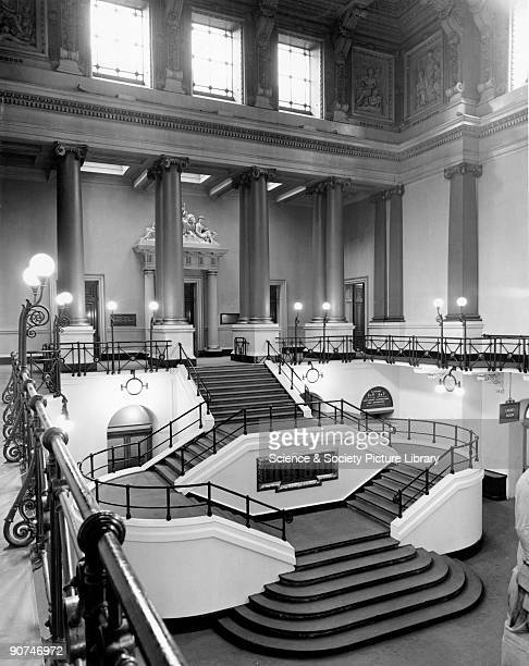 The Great Hall is shown looking north from the balcony with the entrance to the Shareholders' Room visible at the top of the stairs Designed for the...