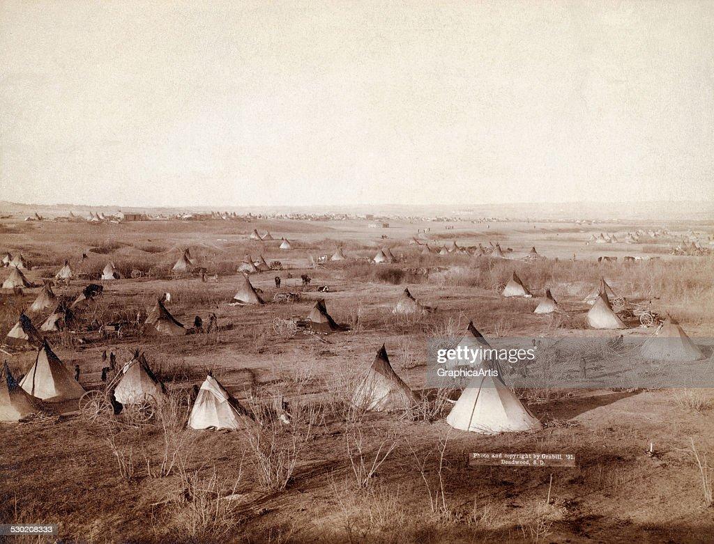 The Great Hostile Camp an expansive vista of the Lakota tribal village on the Pine Ridge Reservation in South Dakota by John CH Grabill 1891