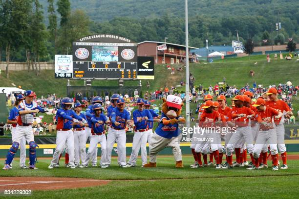 The Great Lakes team from Michigan and the Southwest team from Texas dance with Dugout the mascot ahead of Game 4 of the 2017 Little League World...