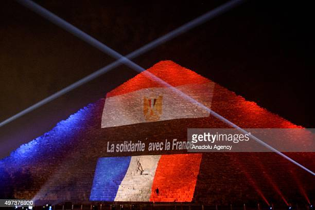The Great Pyramid is illuminated in the colors of the French flag in order to show solidarity after the Paris terror attacks of 13 November in Giza...