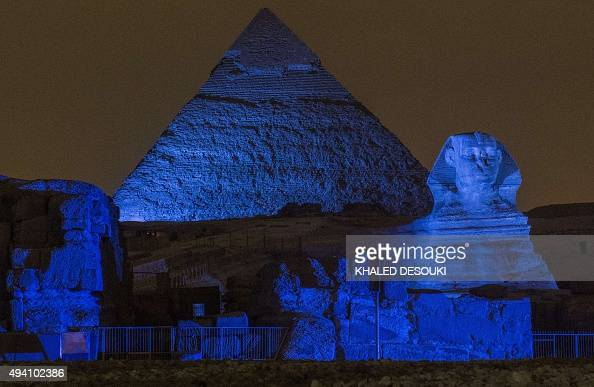 The Great Pyramids and Sphinx in Giza are lit up in blue as part of the 'Turn the World UN Blue' global campaign to celebrate the 70th anniversary of...