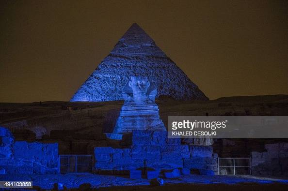 The Great Pyramids and Sphinx in Giza south of Cairo are lit up in blue as part of the 'Turn the World UN Blue' global campaign to celebrate the 70th...