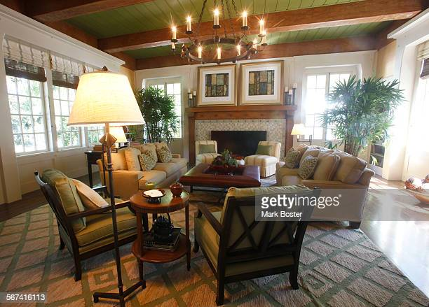 The Great Room designed by Kathryne Designs Inc features a huge fireplace bar and game table in the 1915 English Arts and Crafts home in Pasadena's...