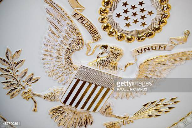The Great Seal of the United States is seen on the center of the ceiling in the Benjamin Franklin State Dining room at the US Department of State...