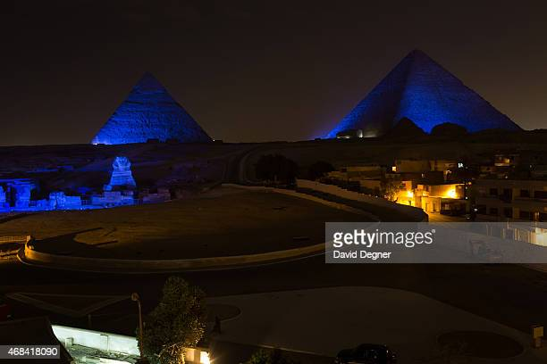The Great Sphinx of Giza and The Great Pyramids of Giza are illuminated in blue to mark the World Autism Awareness Day on April 2 2015 in Cairgo Egypt
