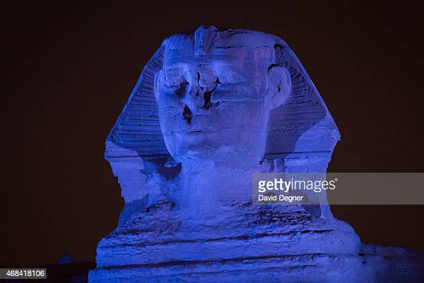 The Great Sphinx of Giza is illuminated in blue to mark the World Autism Awareness Day on April 2 2015 in Cairgo Egypt