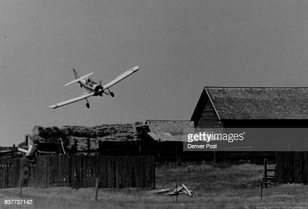 The great Waldo pepper heading for a barn' With a long lens the plane seems to be heading for the barn that sits iron a small hill Crop duster in...