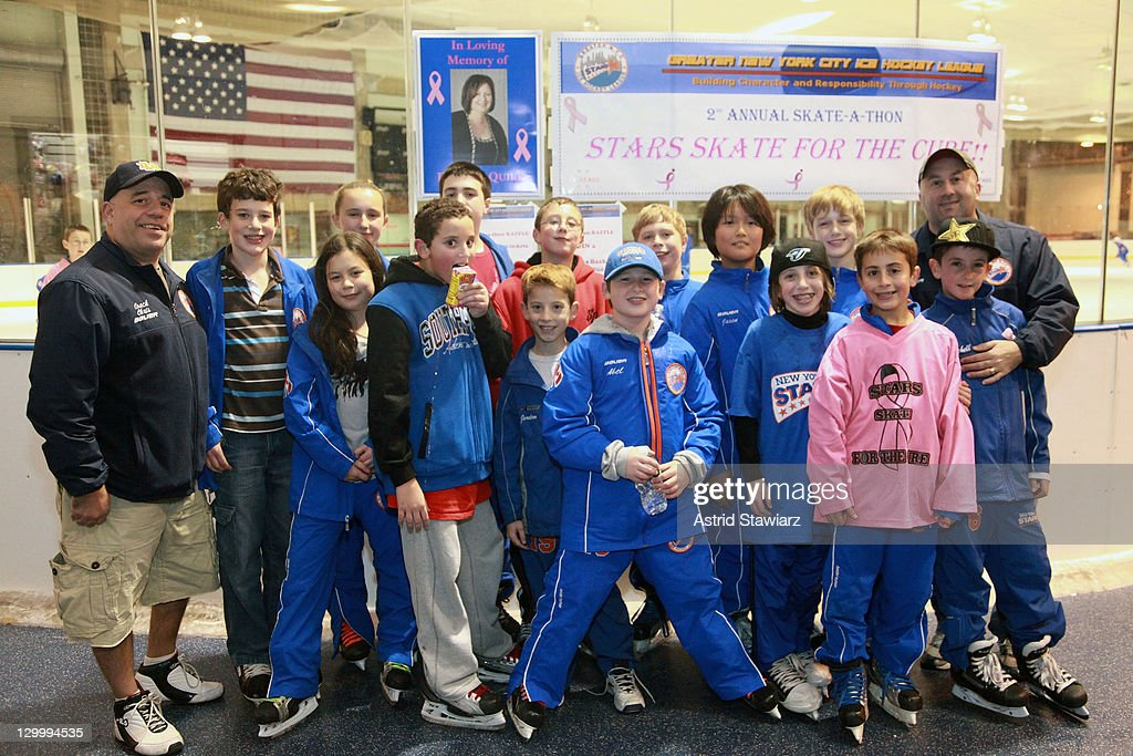 The Greater New York City Ice Hockey League poses for photos during the 2011 Breast Cancer Skate-a-Thon at the Abe Stark Arena on October 22, 2011 in New York City.