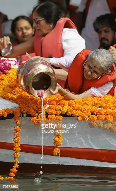 The greatgranddaughter of Indian freedom icon Mahatama Gandhi Nilamben Parikh immerses ashes into the Arabian sea in Mumbai 30 January 2008 A...