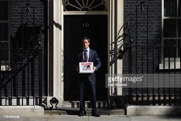 The greatgrandson of Winston Churchill Alexander Perkins poses for a picture outside 10 Downing Street before delivering a petition on August 14 2013...