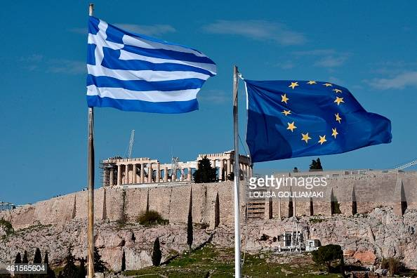 The Greek and EU flags flutter in front of the ancient Acropolis hill in Athens on January 15 2015 Before snap elections were unexpectedly called in...