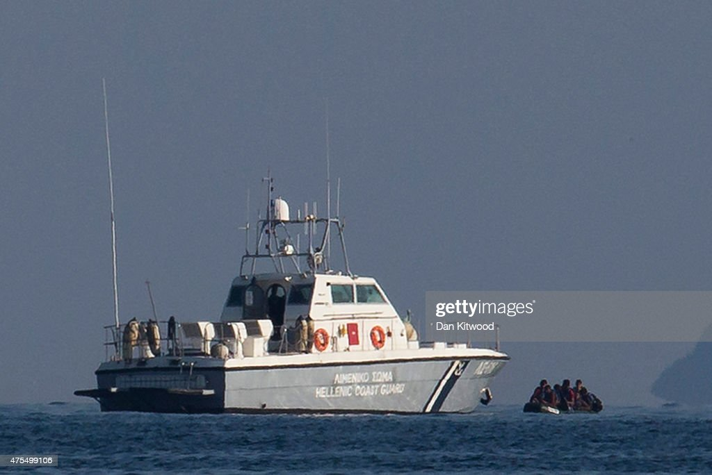 The Greek coastguard picks up a dinghy carrying 7 migrant men off the Turkish coastline on June 01 2015 in Kos Greece Migrants are continuing to...