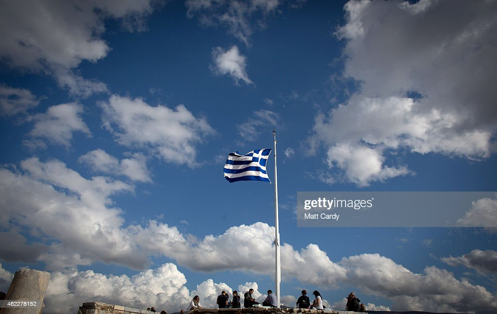The Greek flag flies at the Acropolis following the electoral success by Syriza in the Greek general election yesterday on January 26 2015 in Athens...