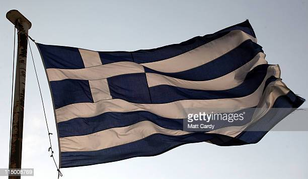 The Greek flags above the city at Mount Lycabettus on June 1 2011 in Athens Greece The Greek government is trying to implement a further round of...