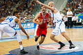 The greek guard Nick Calathes defends against a drive to the basket by The iranian small forward Mohammad Jamshidi in the match between Greece and...