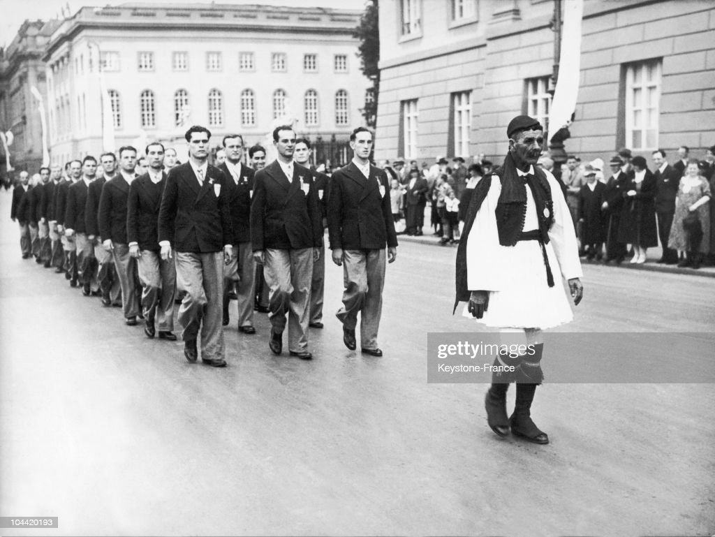 The Greek Men'S Team Filing Through The Streets Of Berlin For The Olympic Games Of 1936, And Being Led By Spiridon Louys, The Former Olympic Marathon Champion In 1896.