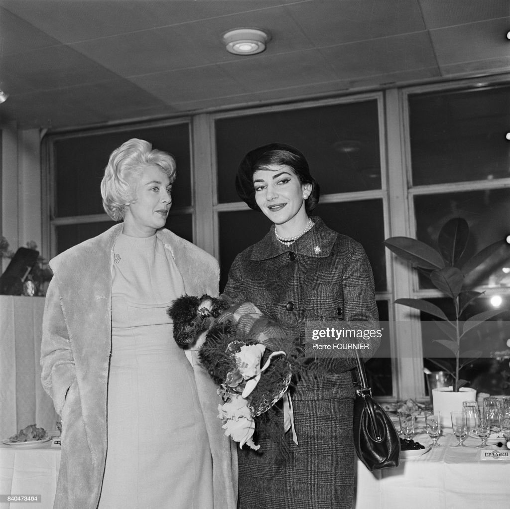 The Greek Opera singer Maria Callas holding her dog in Orly near Paris, 1st January 1958