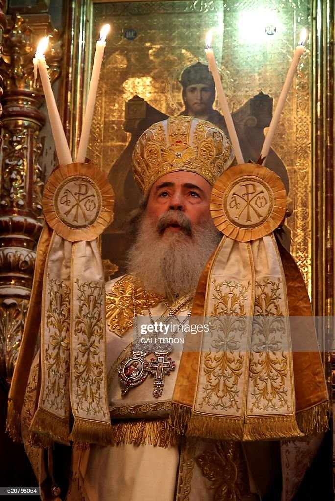 The Greek Orthodox Patriarch of Jerusalem Theophilos III leads the Orthodox Easter Sunday mass at the Church of the Holy Sepulchre in Jerusalem's Old City on May 1, 2016 as Orthodox Christians celebrate the resurrection of Jesus. / AFP / GALI