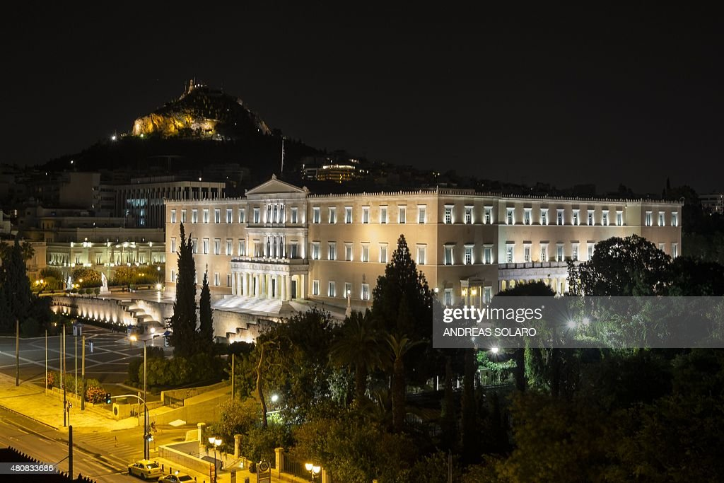 The Greek Parliament is seen at night after the vote for tough reforms demanded by eurozone creditors in Athens on July 16 in exchange for a huge new...