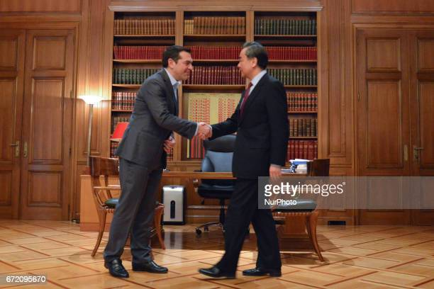The Greek PM Alexis Tsipras welcomes the Minister of Foreign Affairs of China Wang Yi who is visiting Greece in Athens on April 23 2017