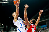 The greek power forward Ioannis Papapetrou moves the ball to the basket while The iranian power forward Hamed Hadadi defends in the match between...