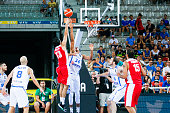The greek small forward Giannis Antetokounmpo defends against a drive to the basket by the iranian small forward Mohammad Jamshidi in the match...