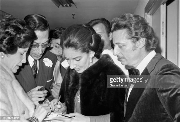 The Greek soprano Maria Callas and Spanish tenor Alfredo Kraus signing autographs Madrid Spain