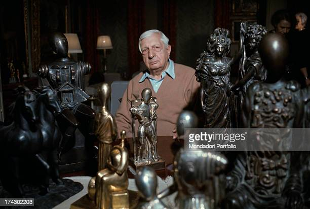 The Greekborn Italian artist Giorgio de Chirico founder of the metaphysical art movement is posing in the terrace of his house in the Palazzetto dei...