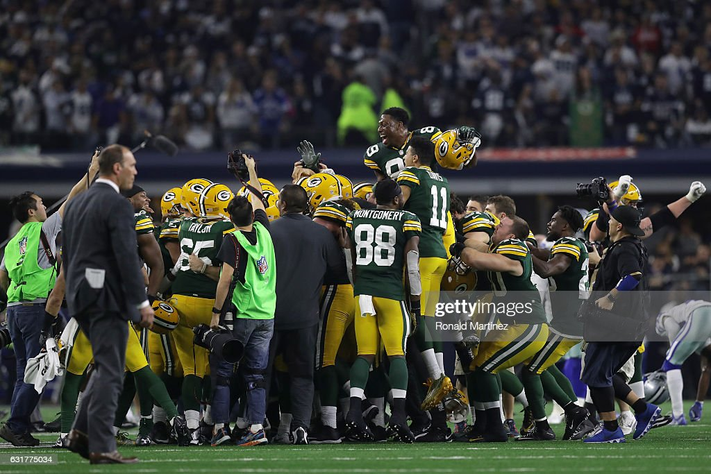 The Green Bay Packers celebrate after the game-winning field goal by Mason Crosby #2 against the Dallas Cowboys in the NFC Divisional Playoff game at AT&T Stadium on January 15, 2017 in Arlington, Texas.