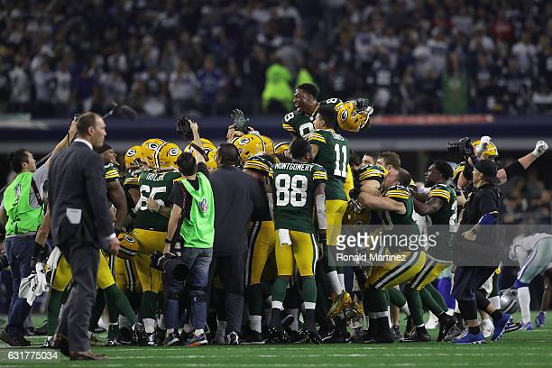 The Green Bay Packers celebrate after the gamewinning field goal by Mason Crosby against the Dallas Cowboys in the NFC Divisional Playoff game at ATT...