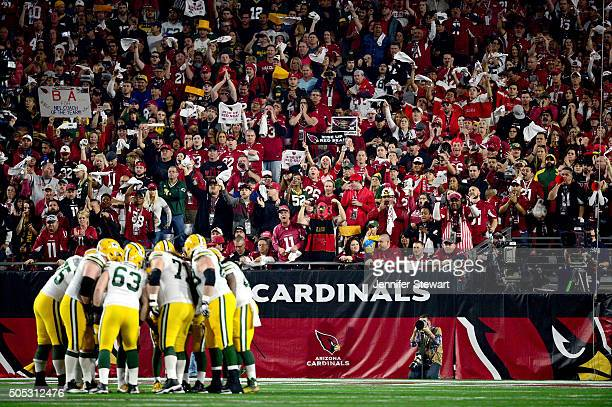 The Green Bay Packers huddle in the first quarter while taking on the Arizona Cardinals in the NFC Divisional Playoff Game at University of Phoenix...
