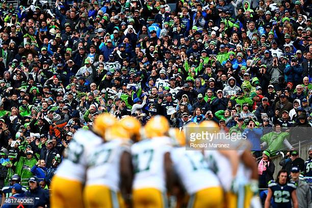The Green Bay Packers huddle in the fourth quarter of the 2015 NFC Championship game against the Seattle Seahawks at CenturyLink Field on January 18...