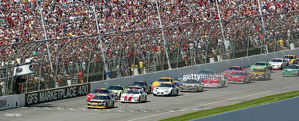 The green flag is waved to start the NASCAR Nexel Cup GFS Marketplace 400 race at Michigan International Speedway in Brooklyn Michigan on Sunday...